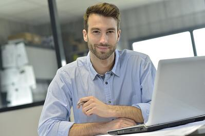 Businessman in office working on laptop-1