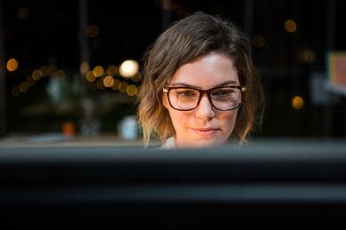Close-up of businesswoman working on computer at her desk in the office