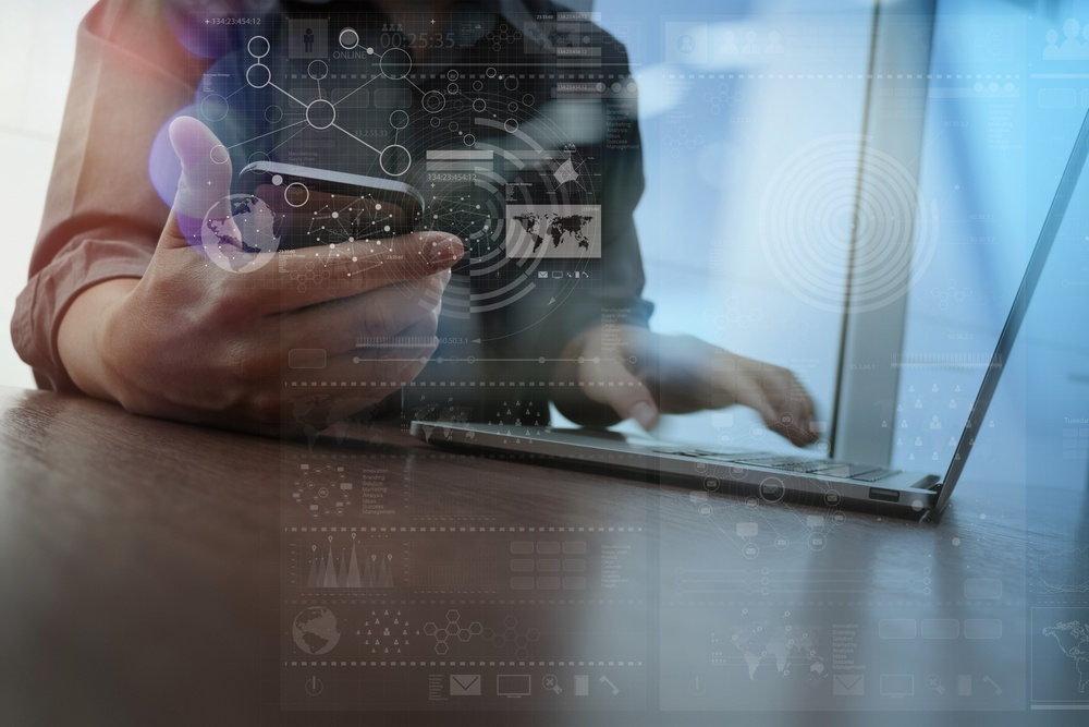 Double exposure of businessman hand working with mobile phone and modern computer and business strategy as concept.jpeg