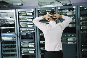 it business man in network server room have problems and looking for  disaster situation  solution.jpeg